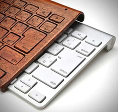 iMac Keyboard Wooden Cover http://coolpile.com/gear-magazine/imac-keyboard-wooden-cover/ via @CoolPile.com