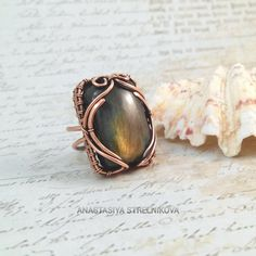 Wire wrapped Ring with labradorite #wirework #copperring #wirewrapped…