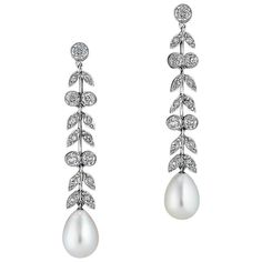 Art Deco Diamond Pearl and Platinum Drop Earrings | From a unique collection of vintage drop-earrings at https://www.1stdibs.com/jewelry/earrings/drop-earrings/