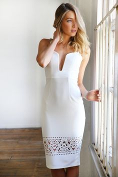 White Plunged Neckline Bodycon Midi Dress. Beautiful white bodycon midi dress with laser cut detail on the bottom hem. Wire sculpted plunging neckline (bust is slightly padded). Adjustable straps with back center invisible zip. Fabric: polyester (slight stretch in fabric). #ustrendy www.ustrendy.com