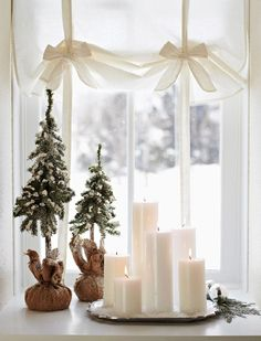 in Snow-White Style - Group candles in a window for a warm holiday decoration. For more shots of this house: www.midwestl -Decorate in Snow-White Style - Group candles in a window for a warm holiday decoration. For more shots of this house: www. Noel Christmas, Little Christmas, Christmas And New Year, All Things Christmas, Winter Christmas, Christmas Vignette, Christmas Candles, Rustic Christmas, Modern Christmas