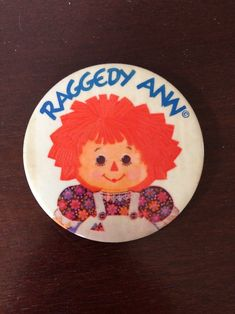 """On the front it says """"Raggedy Ann"""" in blue with Raggedy Ann below it. As with age the pin shows wear as shown. Raggedy Ann And Andy, Vintage, Vintage Comics"""