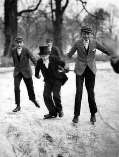 Eton College schoolboys skating to school. Berkshire, England 1929