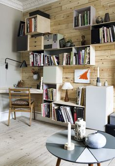 Find interior inspiration from this awesome DIY bookshelf which is super personal and creative.