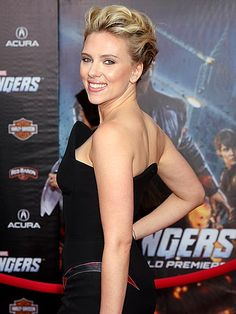 Scarlett Johansson greets fans from the red carpet Wednesday at the Hollywood premiere of The Avengers, in which she reprises her role as sexy assassin Black Widow. The superhero flick hits theaters on May 4. Read more: http://www.people.com/people/gallery/0,,20586227,00.html#21145408
