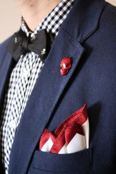 Red skull lapel pin Subtle humor and comic fun interjected into this look.