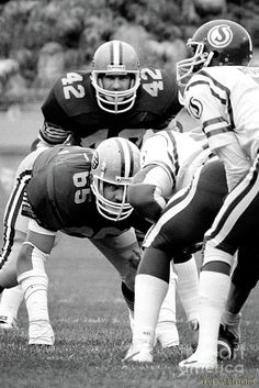 Photograph taken of Edmonton Eskimos defensive lineman Dave Fennell #65, ready to attack on this play against the Saskatchewan Roughriders in this 1982 game.