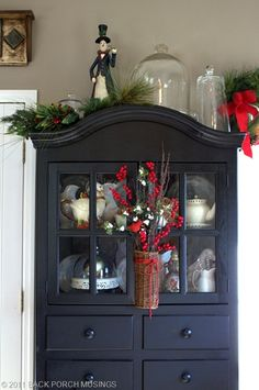 Love the black hutch and the snowman in the long black tail coat on top!  Beautiful!!  From: http://backporchmusings.typepad.com/blog/page/3/