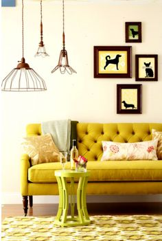 I love this mustard yellow chesterfield. I think lots of people find yellow obnoxious in design, but I think it is visually interesting. Also love the light fixtures here.