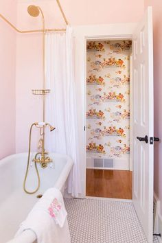 Part retro, part modern, the tiny hexagon tiles work well in this blush pink bathroom. The palette of pink, white and gold work together to make this bathroom totally relaxing without being boring.