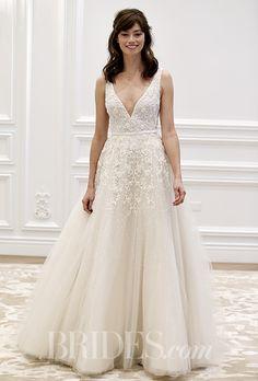 An A-line @annebargebride wedding dress with a deep V-neck   Brides.com