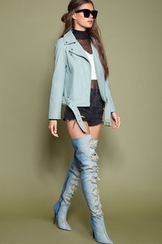 Style Deals - A faux leather moto jacket featuring an asymmetrical zip-up front, notched lapels, two front slit pockets, left zippered pocket accent, a belted waist, and long sleeves.