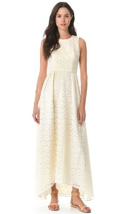 Wedding Prep: 23 Dresses Perfect For Your Rehearsal Dinner: For the girl who wants something laid-back but superpretty, weve got just the dress for you: Shoshannas Lace Belinda Gown ($550) is a maxi dress at heart, but thanks to pleating and a floral-detailed finish, it feels very elegant, too.