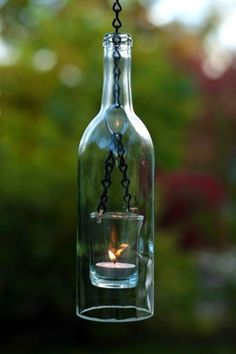 Home recycling glass wine bottles is a great idea. There are many creative ideas on how to use old glass bottles. Check out a collection of great ideas on how to make beautiful decorations from glass Wine Bottle Lanterns, Bottle Lights, Wine Bottle Crafts, Bottle Art, Bottle Candles, Diy Bottle, Glass Candle, Candle Lamp, Bottle Torch