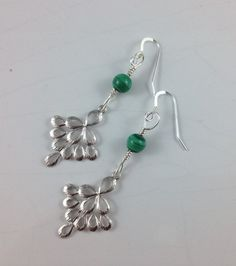 A personal favorite from my Etsy shop https://www.etsy.com/listing/223282603/peacock-and-malachite-dangler-earrings