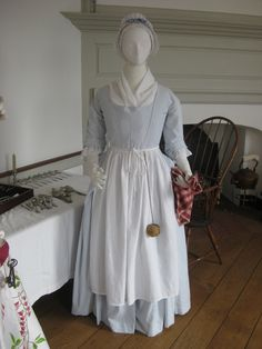 Housekeeper wearing a round gown (robe à l'anglaise), c. 1775 Striped linen round gown, reproduction of an extant item in the Philadelphia Museum of Art; pinball adapted from extant item in the Chester County Historical Society.
