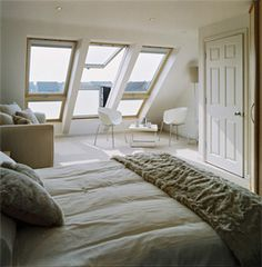 Lovely cream/grey themed bedroom in attic space.