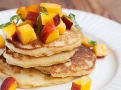 sweet corn pancakes with peaches and basil