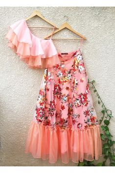 Peach One Shoulder Ruffle Top & Floral Lehenga Shrena hirawat Indian Gowns Dresses, Indian Fashion Dresses, Dress Indian Style, Indian Designer Outfits, Girls Fashion Clothes, Designer Dresses, Indian Wedding Outfits, Bridal Outfits, Indian Outfits
