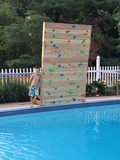 I decided to add some fun to the Pool by building my own Climbing Rock Wall that hangs over the pool. This is a great project that has brought a lot more fun...