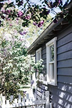 The home's exterior is painted in a custom grey-lilac colour while the windows are shaded by lilac blooms Exterior Colors, Exterior Paint, Exterior Design, Painted Cottage, Cottage Exterior, Lilac Color, Garden Trees, Outdoor Rooms, Country Style