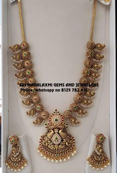 One of the best Mango haram. Presenting Nakshi work heavy long haram Visit for best designs. Contact no 8125 782 411 . Gold Temple Jewellery, Gold Wedding Jewelry, Bridal Jewelry, Gold Jewelry, Pearl Necklace Designs, Gold Earrings Designs, Antique Jewellery Designs, Gold Jewellery Design, Fashion Jewelry