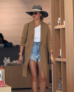 Chrissy Teigen Oversized Sunglasses - Chrissy Teigen donned a pair of oversized shades for extra sun protection.