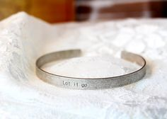 Hey, I found this really awesome Etsy listing at https://www.etsy.com/listing/190964580/let-it-go-bracelet-engraved-letter