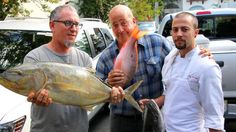 Andrew with chef Michael Schwartz and chef de cuisine Bradley Herron with the catch of the day at Michael's Genuine restaurant in Miami
