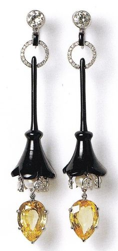 A pair of Art Deco pendant earrings, Cartier Paris for Cartier New York, circa 1919. Onyx, diamonds and yellow sapphires set in platinum.