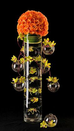 Centerpiece by Daniela: Wow! This could be fun with some orange orchids on top and blue flowers down the sides (or inside the vase)