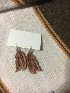 https://www.etsy.com/listing/505969688/feather-leather-earrings?ref=shop_home_active_9