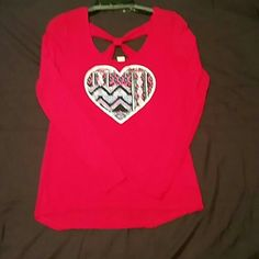 Long Sleeve Heart Top Self Esteem Never been worn. Long sleeve top with heart on the front and a bow in the back. Self Esteem Tops