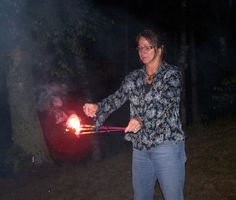 It's an IB campfire, and Terri shows her skill juggling three sparklers at once.