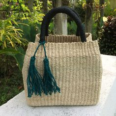 Our Beatrix Box Bag is spacious, convenient, and modish – the perfect travel handbag. You can now travel with style! Travel Handbags, Basket Bag, Box Bag, Malachite, Handmade Bags, Straw Bag, Cord, Tassels, Artisan