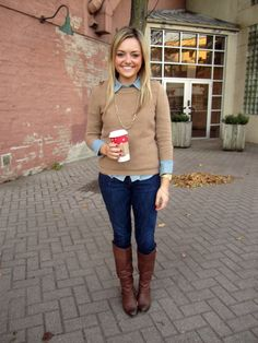 Business casual work outfit: camel sweater, chambray button up, skinny jeans and brown boots.