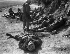 Weary Marines rest upon returning from a dawn raid against Chinese troops, February 6, 1953. According to the source, an estimated 300 Chinese were killed in the American attack.