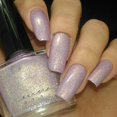 """This lovely swatch by @mimera929 is of the freshly released @femme_fatale_cosmetics customs for @hellaholocustoms .  It has now been named """"Unicorn Treasure Trove."""" This gorgeous polish has a lavender linear holo base with gold flakes and Holo micro glitters. #femmefatalecosmetics #femmefatale #aussienails #australianails #aussieindie #australianmade #AIPAS #aussiepolish #aipaslove #hhc #hellaholocustoms #hellaholo #allthehhcs #hellaholocustomsgroup #nagellack #varnish #esmalte #vernis…"""
