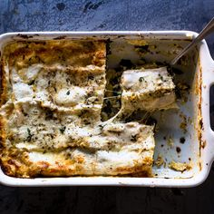 A decent amount of béchamel keeps this tomato-less lasagna moist as it cools.