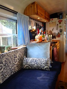 A converted school bus now the full-time home of a young couple.  I like the curtain rod / pot hanger!