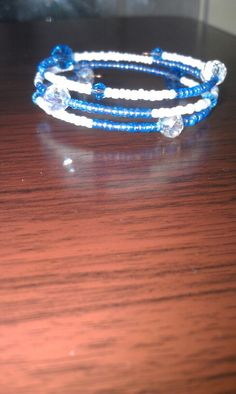 Girls memory wire bracelet with blue & white seed beads. Girls jewelry.