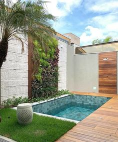Small backyard pool with wooden decking and grass turf around it to reduce mantainence.The wall is treated with vertical garden, stone and woosen cladding as well. modern Backyard with pool Backyard pool with vertical garden. Small Backyard Design, Backyard Patio Designs, Modern Backyard, Small Backyard Landscaping, Backyard Ideas, Small Pool Backyard, Small Garden With Pool Ideas, Garden Modern, Fence Ideas