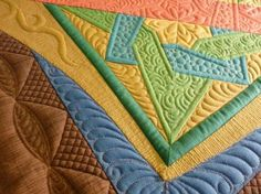 Beautiful quilting.  Love the colors (Quilts of Love) (48 pieces)