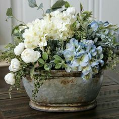 Spray paint the metal oval tin to silver and fill with fake flowers to decorate. Maybe on an entry table?
