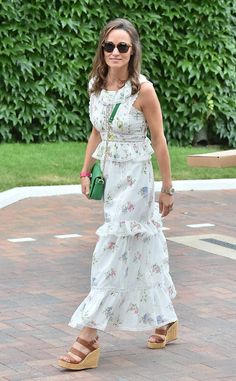 Pippa Middleton from The Big Picture: Today's Hot Photos  Lovely in floral! The socialite is seen rocking a sundress paired with platform sandals during The Championship at Wimbledon.