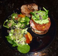 Steak burger with cheese, smoked bacon, avocado salsa & alfalfa