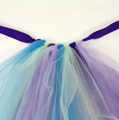 Make your own no sew tutu. Materials: 1. Ribbon 2. Strips of tool  o  Tie the middle of the tool around the ribbon. As many as you need until it fits all the way around the ballerina. :)
