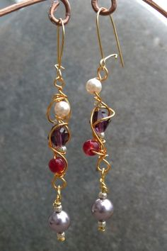 Swirly Wire wrapped Earrings from Shealynn's Faerie Shoppe. I love these!
