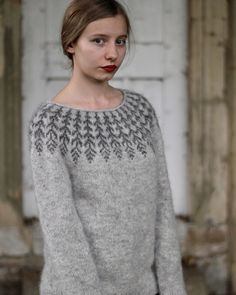 A top-down Icelandic-inspired stranded yoke sweater. This pullover is worked seamlessly from the top down, starting with a simple rolled neckline. The yoke is knit in stranded color work, then short row shaping is added to the back of the sweater to shape Free Knitting Patterns For Women, Sweater Knitting Patterns, Knitting Designs, Knit Patterns, Icelandic Sweaters, Vogue Knitting, Feather Pattern, Fair Isle Knitting, How To Purl Knit