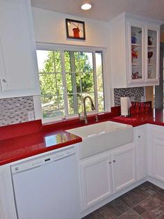 Red and white country kitchen with farmhouse sink.    by dlawson.com